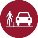 Icon of a red circle with a person riding a bicycle  with a barrier between them and the car in white