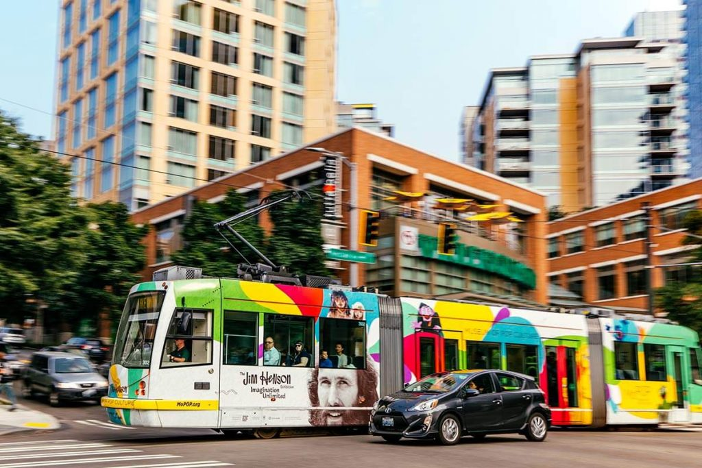 Rapid Streetcar in South Lake Union. Streetcars run on tracks that are embedded in the road. Cars can also still drive on these tracks.